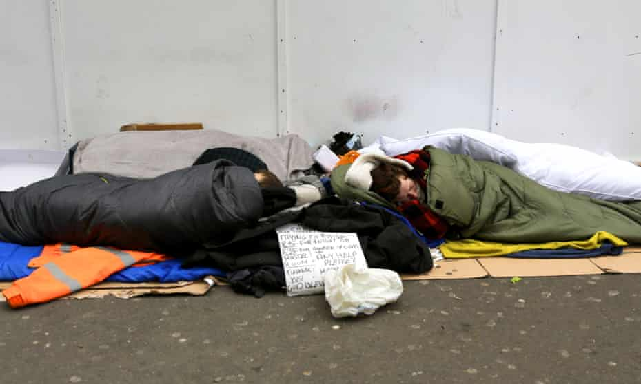 People sleeping outside a tube station in central London