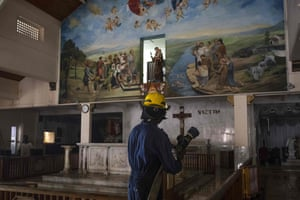 A soldier with a hosepipe cleans St Anthony's shrine following the Easter Sunday bomb blasts.