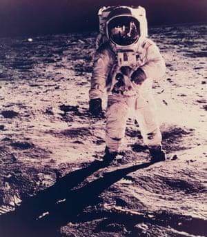 Neil Armstrong is reflected in Aldrin's helmet visor