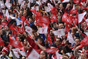Boro fans wave red and white flags.