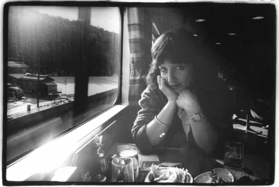 The right profile … Smith on a bullet train in Japan, photographed by Strummer.