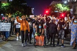 Whitney Mitchell, Garrett Foster's fiancée, attends a march in downtown Austin.