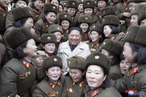 Kim Jong-un poses as he inspects a women's company under unit 5492 of the Korean People's Army.