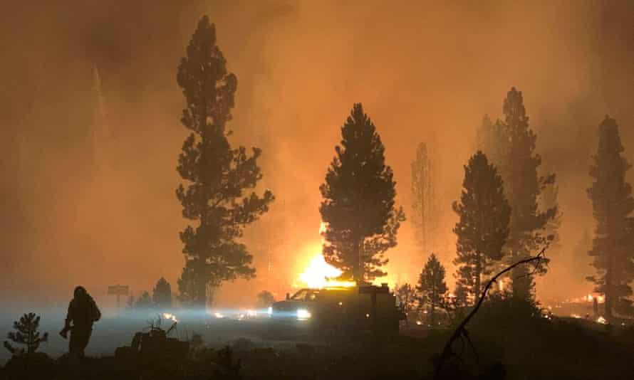 Firefighter tackle the Bootleg fire, near Klamath Falls, Oregon on 17 July.