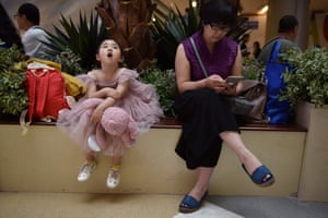 A child model waits her turn at a contest
