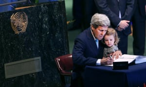 US secretary of state John Kerry holds his granddaughter as he signs the Paris climate agreement.