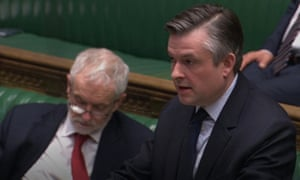 Jonathan Ashworth speaking in the coronavirus bill debate, with Jeremy Corbyn sitting on the Labour front bench beside him.