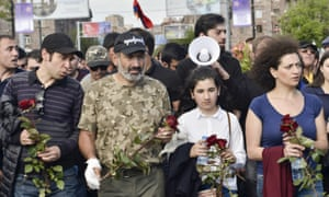 Armenian opposition leader Nikol Pashinyan, second left, leads a march to attend a memorial service at the monument to the victims of the Armenian genocide.
