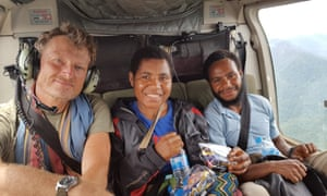 Benedict Allen is airlifted to safety with friends Eka (also sick with malaria) and her husband Peter.