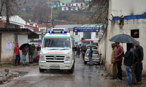 An injured man is transported in an ambulance in the Indian Kashmir frontier town of Mendhar.