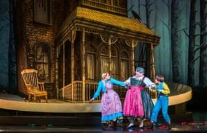 Gerhard Siegel, centre, as the Witch, with Jennifer Davis (Gretel) and Hanna Hipp (Hansel).