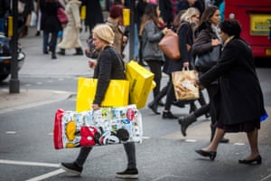 Black Friday Bargain Hunters Hit The Streets<br>LONDON, ENGLAND - NOVEMBER 28: A woman carries bags of shopping on Oxford Street during 'Black Friday' sales on November 28, 2014 in London, England. Originating in the USA as a sales day that following the Thanksgiving holiday, 'Black Friday' is becoming an increasingly popular shopping day in the UK. (Photo by Rob Stothard/Getty Images)
