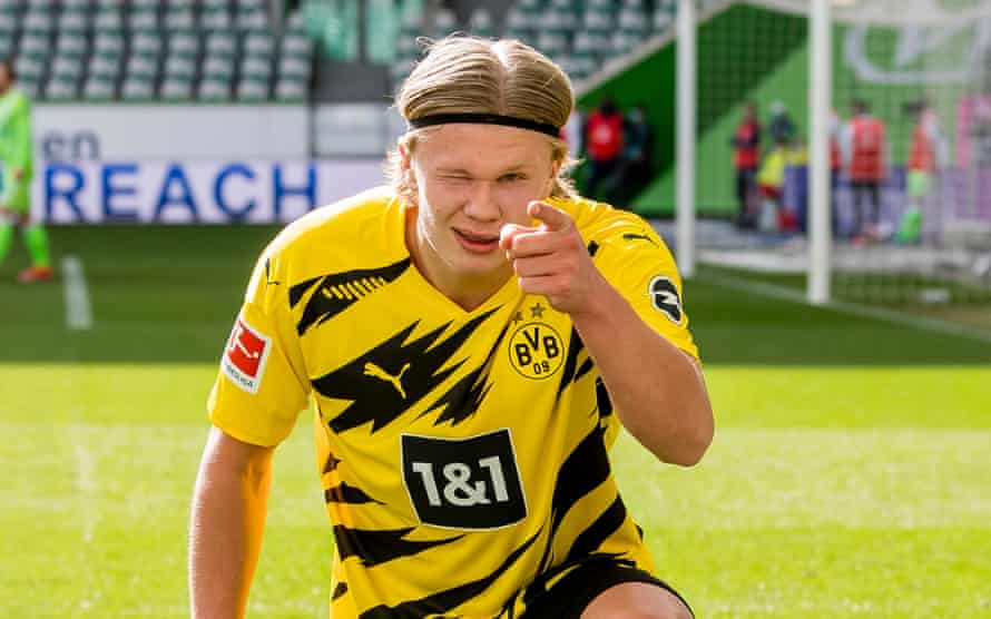 Erling Haaland celebrates one of his two goals against Wolfsburg.