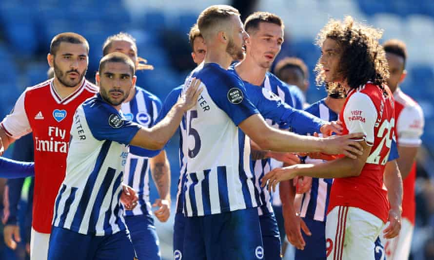 Brighton's Neal Maupay is shielded from Arsenal's Matteo Guendouzi after the final whistle