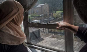 Khayrun Begum looks out of the window of Sophie Spielman's flat in Treves House.