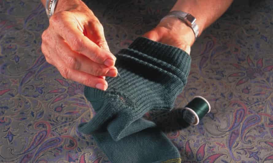 Woman darning socks