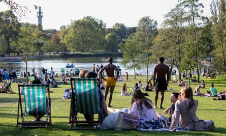 People relaxing in Regent's Park, London, days before the introduction of a six-person limit on indoor and outdoor social gatherings in England.