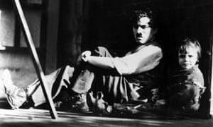 Charlie Chaplin and Jackie Coogan in The Kid