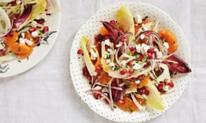 Satsuma, pomegranate, fennel and chicory salad with feta  on a round white dish