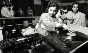 Rani Kaur, aka DJ Radical Sister, mixing records at a day timer in the 90s.