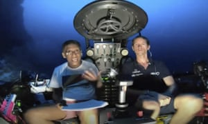 Danny Faure (left) speaking from inside the submersible