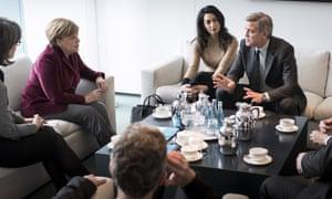 George and Amal Clooney meet Angela Merkel at the Federal Chancellery in Berlin.