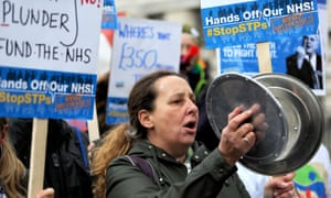 Campaigners outside Downing Street during a protest called by the Hands Off Our NHS campaign last week.