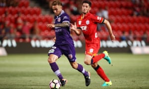 Adam Taggart of Perth Glory gets away from Dylan McGowan of Adelaide United.