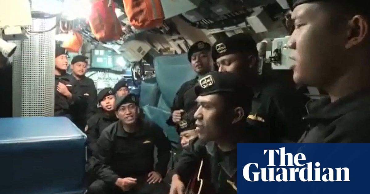 Poignant video shows crew of sunken Indonesia submarine singing farewell song