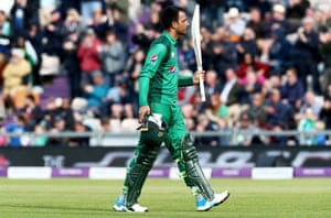 Fakhar Zaman of Pakistan soaks up the applause as he leaves the field after being caught out by Jos Buttler of England.