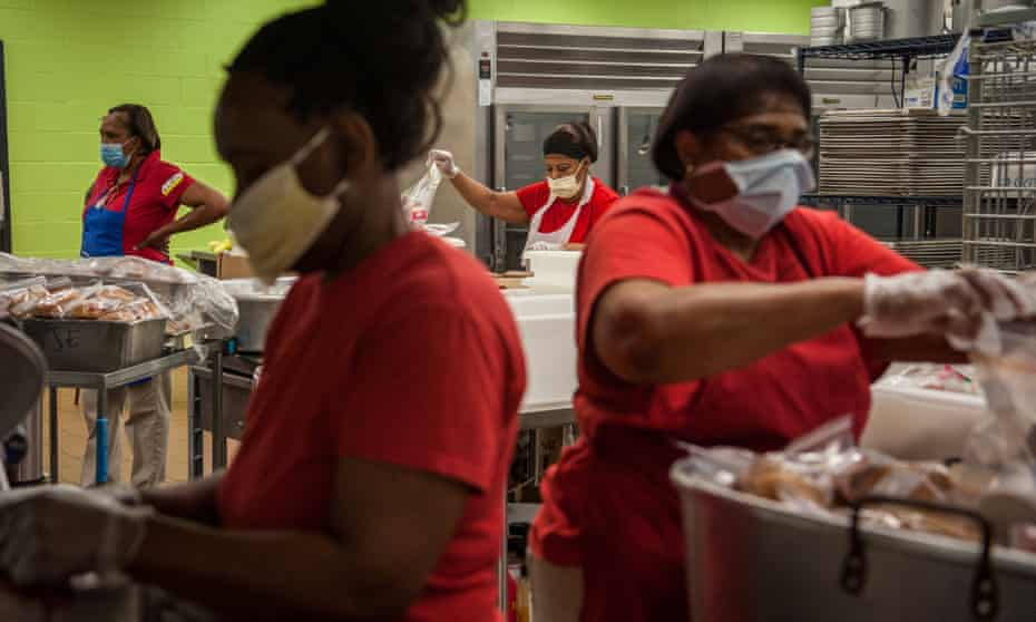 Cafeteria staff members prep delivery meals at William Dean Jr elementary school in Lexington, Mississippi, on 1 April.
