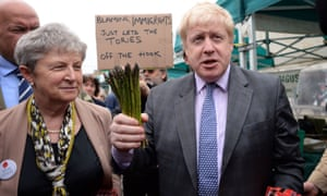Boris Johnson buys asparagus at Truro market