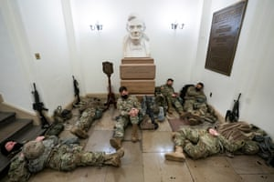 Washington DCMembers of the National Guard try to get some sleep inside the US Capitol