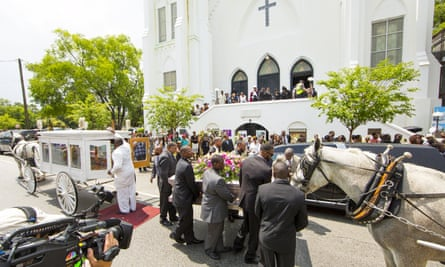 The casket of shooting victim Susie Jackson is brought into the Mother Emanuel AME church.