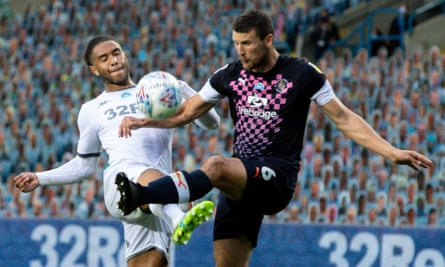 Leeds' Tyler Roberts (left) battles with Luton's Matty Pearson during their Championship match on Tuesday.