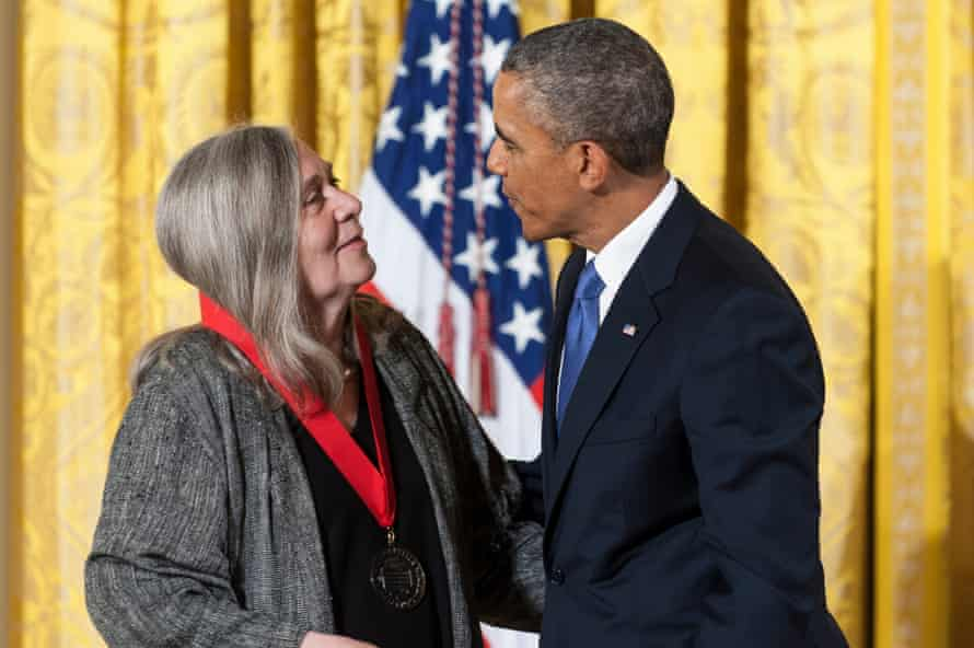 President Obama presents a National Humanities medal to Robinson at the White House in 2013.