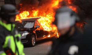 Police and demonstrators clash in downtown Washington after a limo was set on fire following the inauguration of Donald Trump.