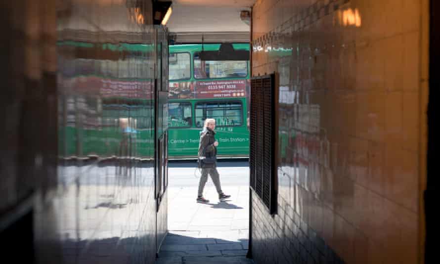 A woman walks near an alley in Nottingham City Centre
