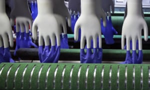 Newly made gloves inside the Top Glove factory at Setia Alam, outside Kuala Lumpur in Malaysia. Top Glove is the world's largest rubber glove manufacturer.