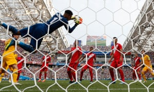 Peru's goalkeeper Pedro Gallese catches the ball
