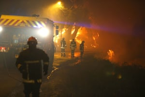 Firefighters work to extinguish flames in Biguglia