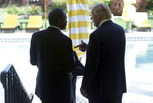 Ben Carson speaks with Donald Trump after a news conference at the Mar-A-Lago Club in Palm Beach, Florida.