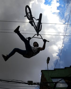 A downhill rider performs acrobatics during the Adrenalina Urban Bike race final