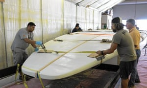 The world's biggest surfboard being built Westerly Marine, a Santa Ana builder, California.