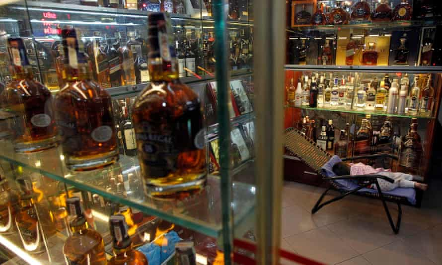 A child sleeps at a shop selling whisky in Hanoi, Vietnam.