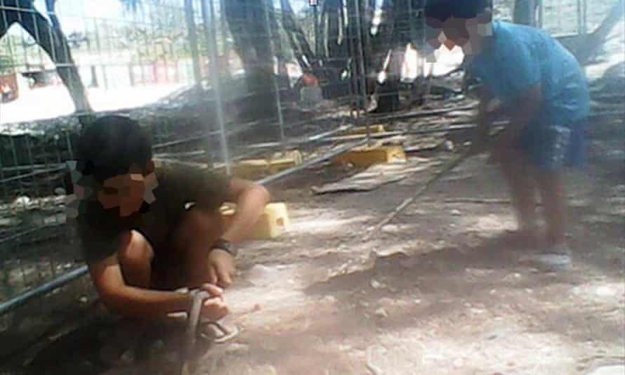 Asylum seeker children play in the dirt at the Australian-run immigration detention centre on Nauru.