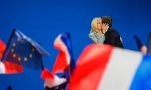 Emmanuel and Brigitte Macron embrace after the results of the first-round vote are announced.