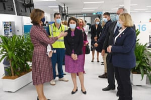 NSW premier Gladys Berejiklian and NSW health minister Brad Hazzard visit the Olympic Park vaccination centre in Sydney on Monday morning. The hub will be open to people in categories 1a and 1b before expanding to anyone over 50 from 24 May.