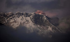The last light of the day sets on Mount Everest as it rises behind Mount Nuptse as seen from Tengboche, in the Himalaya's Khumbu region, Nepal.