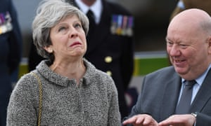 Theresa May and the mayor of Liverpool, Joe Anderson, watch a parade of military personnel to mark Armed Forces Day in Liverpool last week